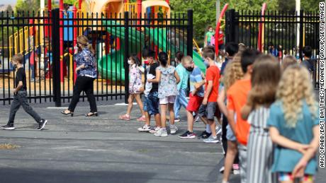 Teacher Nusheen Saadat, second from left, leads students across campus during a summer school session June 14 at Golden View Elementary School in San Ramon, California.