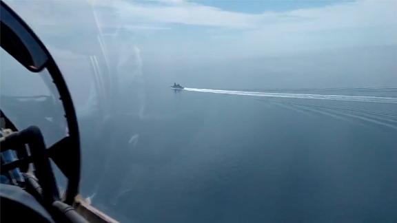 Image of Russian Black Sea Fleet and border patrol boat's prevention of the breach of the Russian state border committed by the UK Navy destroyer Defender on June 24, 2021. The Russian Defence Ministry said a border patrol boat fired the shots at HMS Defender after it entered the country's territorial waters in the Black Sea. It also said that a Su-24M warplane dropped four bombs close to the ship. Britain dismisses Russian claims, saying that the 152 metre-long, 8,500-tonne vessel was conducting innocent passage through Ukrainian territorial waters in accordance with international law. In a statement posted on Twitter, it said: We believe the Russians were undertaking a gunnery exercise in the Black Sea and provided the maritime community with prior warning of their activity. No shots were directed at HMS Defender and we do not recognise the claim that bombs were dropped in her path.<0x0a> (Newscom TagID: eyepress104890.jpg) [Photo via Newscom]