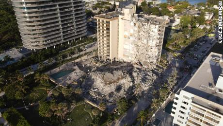 Little fingers and screams led dog walker to boy trapped in Florida condo rubble