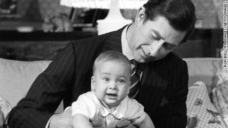 Prince Charles cradles his son Prince William at Kensington Palace in 1982.
