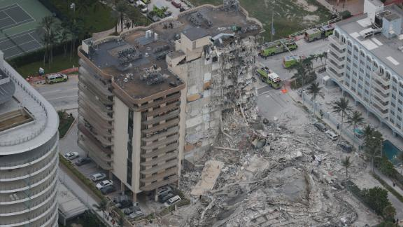 The partial collapse left huge piles of rubble and materials dangling from what remained of the structure.