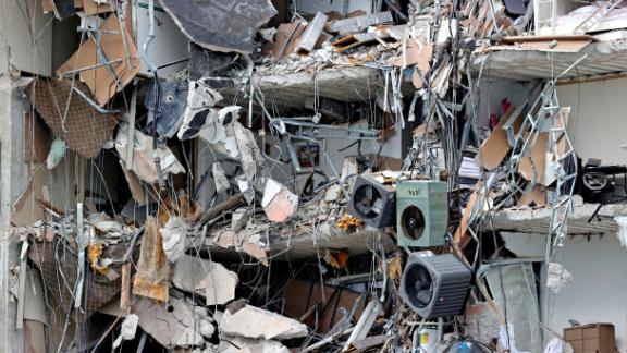 Debris dangles from the building on June 24.