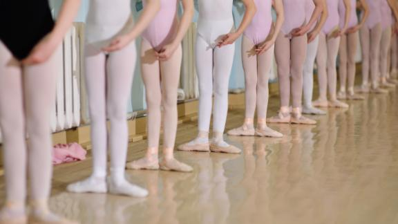 Girls line up in pink tights for a ballet class. Can't we make room on the floor for boys who love to dance?