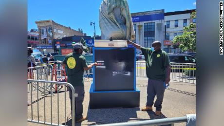 City workers were cleaning the statue in Brooklyn on Thursday.