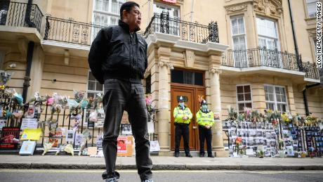 Former Myanmar Ambassador to the UK Kyaw Zwar Minn listens to a statement being read on his behalf as he stands outside the Myanmar Embassy on April 8, 2021 in London, England.