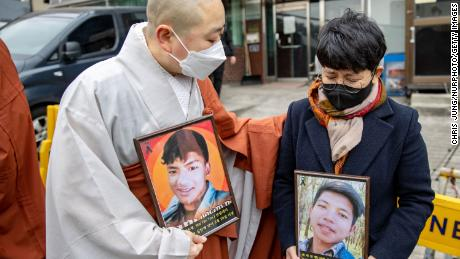 A South Korean monk comforts Myanmar national who cries in front of the Myanmar Embassy on February 25, 2021 in Seoul, South Korea during protests against the military coup in Myanmar.