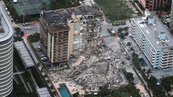 SURFSIDE, FLORIDA - JUNE 24:  In this aerial view, search and rescue personnel work after the partial collapse of the 12-story Champlain Towers South condo building on June 24, 2021 in Surfside, Florida. It is unknown at this time how many people were injured as search-and-rescue effort continues with rescue crews from across Miami-Dade and Broward counties. (Photo by Joe Raedle/Getty Images)