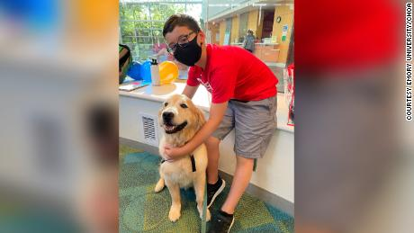 Brody Parker is shown with one of the therapy dogs that visit the Children's Healthcare of Atlanta hospitals.