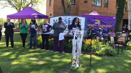 """Chaunte Jones speaking at an """"Essential Worker Appreciation Day"""" event with Gov. Gretchen Whitmer in Detroit, Michigan, earlier this month."""