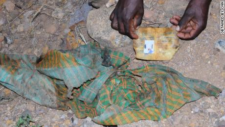 One photograph from the scene of clothing and an ID card left at the scene of the massacre in Mahibere Dego, Tigray.