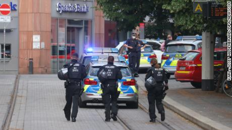 Police officers respond following the attack.