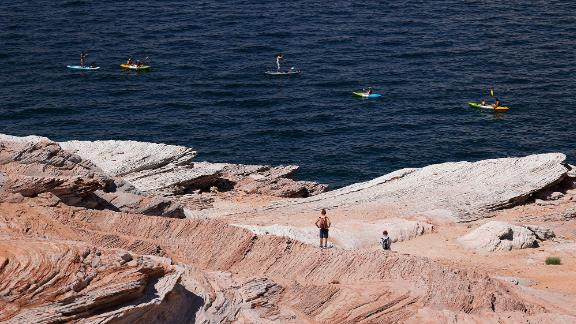Kayakers navigate the waters of Lake Powell in Page, Arizona, on June 24.