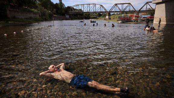 Gerry Huddleston cools off in the shallow water of the Russian River in Healdsburg, California, on June 16.