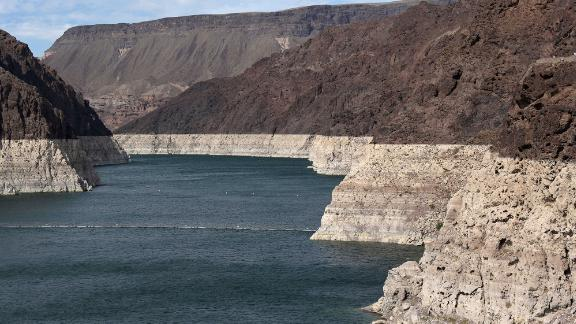 """Low water levels can be seen in the Hoover Dam reservoir of Lake Mead on June 9. <a href=""""https://www.cnn.com/2021/05/27/weather/lake-mead-colorado-river-shortage/index.html"""" target=""""_blank"""">Water levels at Lake Powell and Lake Mead</a> -- the two largest reservoirs on the Colorado River -- have dropped at an alarming rate."""