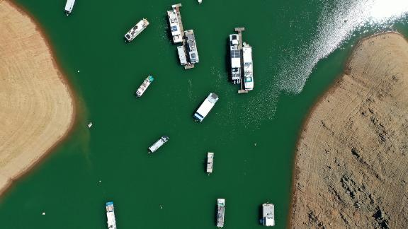 This aerial photo shows houseboats anchored at the Bidwell Canyon Marina in Oroville, California, on June 1. As water levels continued to fall at Lake Oroville, officials were flagging houseboats for removal so they could avoid being stuck or damaged.