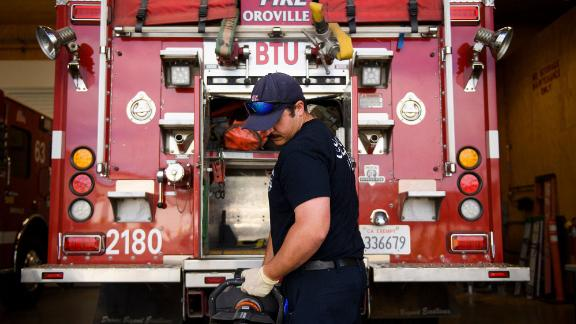 A firefighter inspects equipment on a Type 3 engine designed for wild land firefighting at a station in Oroville, California, on May 26.