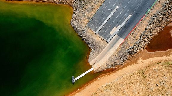 A launch ramp, extended to accommodate low water levels, stretches into California's Lake Oroville on May 22. At the time of this photo, the reservoir was at 39% of capacity and 46% of its historical average.