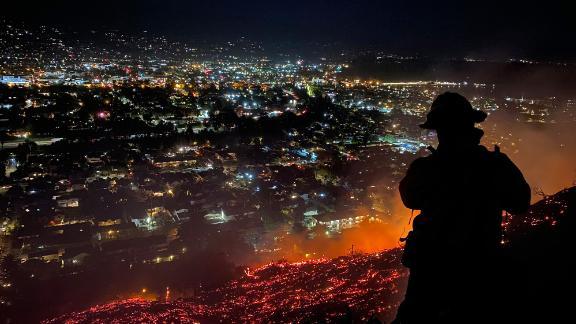 Firefighters battle a brushfire in Santa Barbara, California, on May 21.