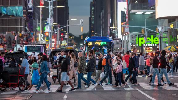 NEW YORK, NEW YORK - JUNE 12: Large crowds of people mostly without masks fill Times Square  on June 12, 2021 in New York City. New York Governor Andrew Cuomo announced pandemic restrictions to be lifted on May 19.  (Photo by Alexi Rosenfeld/Getty Images)