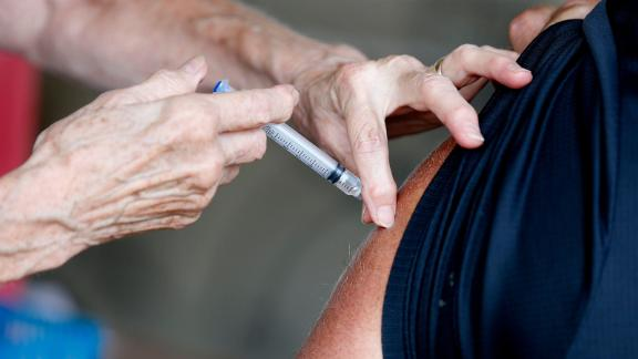 A man receives a COVID-19 vaccine at a vaccine clinic at Mother's Brewing Company in Springfield, Mo. on Tuesday, June 22, 2021. Greene County, Mo., where Mother's Brewing is located, is seeing an average of 94 new COVID-19 cases per day, 93 percent of which are the Delta Variant.  Tmothers Brewing Vaccine00067