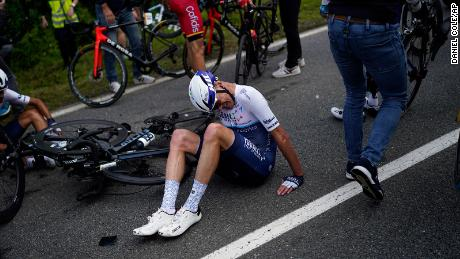 Froome lies on the road after crashing in the second crash of the first stage of the Tour de France.