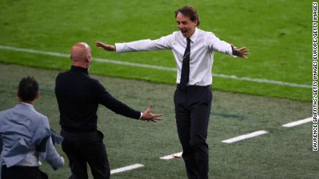 Italy manager Roberto Mancini celebrates after Chiesa scored Italy's goal against Austria.