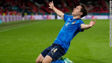 Chiesa celebrates after scoring the opening goal for Italy against Austria at Wembley Stadium.