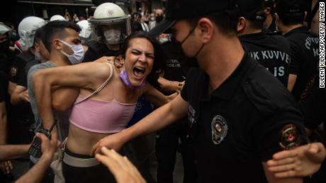 A protester is detained by police at the Pride event in Istanbul on Saturday.