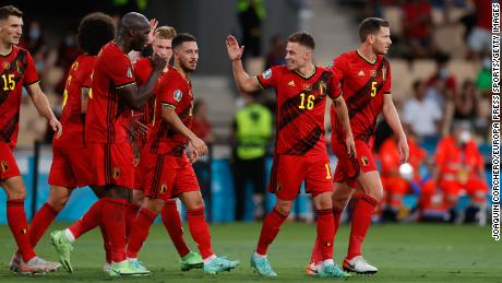 Hazard celebrates with his  teammates after scoring against Portugal.