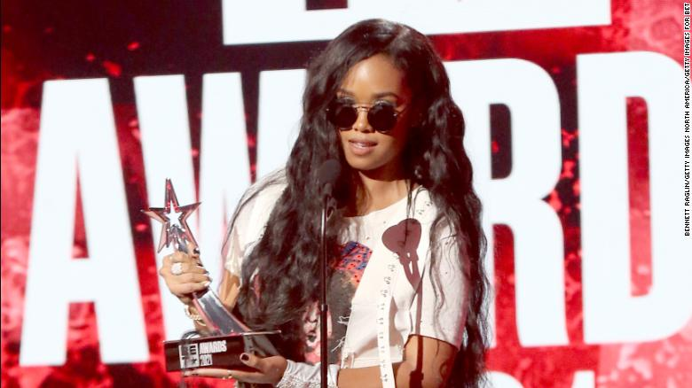 H.E.R. accepts the Best Female R&B/Pop Artist award onstage at the BET Awards on Sunday.