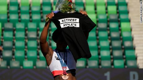Berry displays a T-shirt during her podium protest at the Olympic trials.