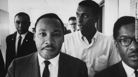 Civil rights leaders Floyd B. McKissick, left, the Rev. Martin Luther King Jr., second left, and Stokely Carmichael, second from the right, during a march through Mississippi to encourage voter registration.