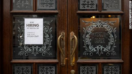 A hiring sign is seen in the window of a pub in Westminster on June 4, 2021 in London, England. Demand for workers in the hospitality sector has increased significantly following the easing of coronavirus restrictions, but many businesses are struggling to find staff.