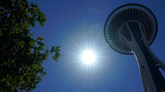 The sun shines near the Space Needle, Monday, June 28, 2021, in Seattle. Seattle and other cities broke all-time heat records over the weekend, with temperatures soaring well above 100 degrees Fahrenheit (37.8 Celsius). (AP Photo/Ted S. Warren)
