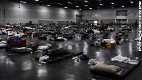 People take refuge at a cooling center in Portland on Monday.