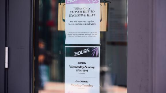 A cafe displays a sign stating they are closed due to excessive heat during a heatwave in Seattle, Washington, U.S., on Sunday, June 27, 2021. Record heat is set to bear down on the Pacific Northwest, threatening fresh strains on regional power and water supplies and dragging down air quality through next week. Photographer: Chona Kasinger/Bloomberg via Getty Images