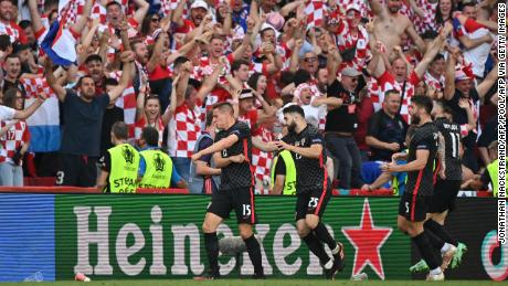 Mario Pasalic celebrates after equalizing for Croatia in stoppage time.