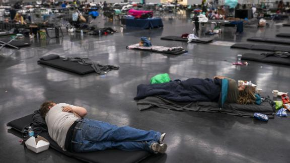 """People in Portland, Oregon, cool off at the Oregon Convention Center on Sunday, June 27. Portland <a href=""""https://www.cnn.com/2021/06/28/weather/heat-waves-west-coast-records/index.html"""" target=""""_blank"""">set an all-time high of 112 degrees</a> that day. It surpassed it a day later with a high of 116."""