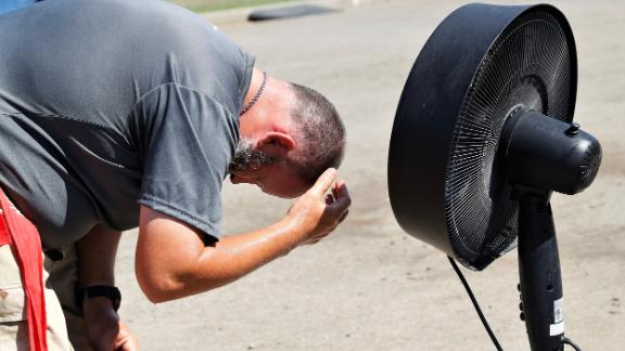 Erik Schonberg cools off with a misting fan Sunday at the Tehama District Fairgrounds in Red Bluff, California. Sunday's high at the Red Bluff Municipal Airport was 105 degrees, according to the National Weather Service.