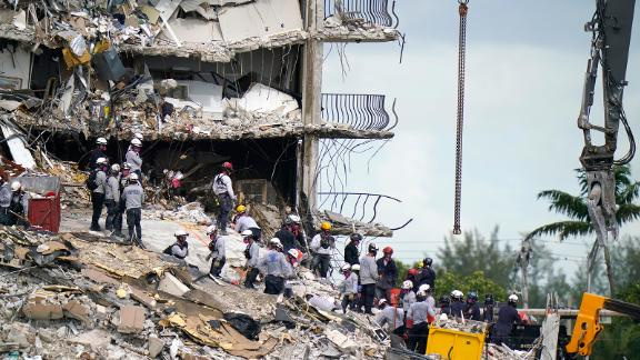 Rescue workers search in the rubble at the Champlain Towers South condominium, Monday, June 28, 2021, in the Surfside area of Miami. Many people are still unaccounted for after the building partially collapsed last Thursday. (AP Photo/Lynne Sladky)
