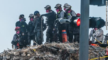 Rescuers search through debris for the sixth day as families wait for answers about their loved ones and what caused the collapse