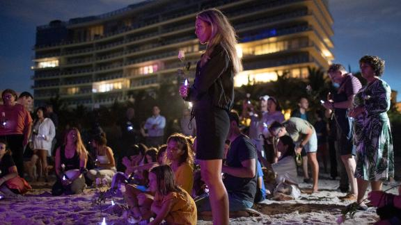 People take part in a twilight vigil near the building on June 28.