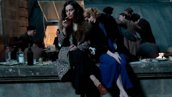 """(From left) Lily James and Emily Beecham star in """"The Pursuit of Love."""""""