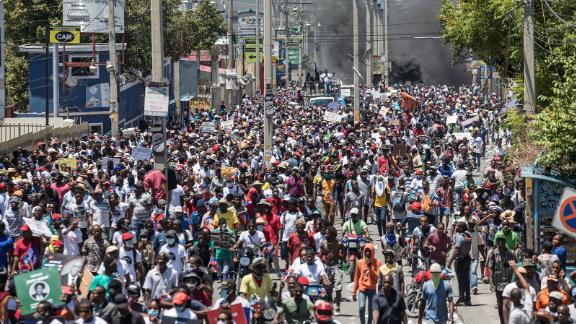 Haitians demonstrate during a protest to denounce the draft constitutional referendum proposed by President Jovenel Moise, on March 28 in Port-au-Prince.