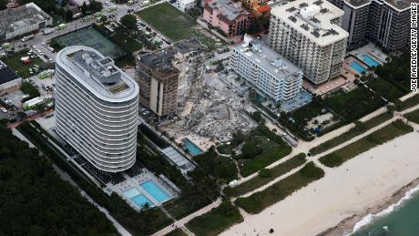 In this aerial view, search and rescue personnel work after the partial collapse of the 12-story Champlain Towers South condo building. Eighty Seven Park is to the left.