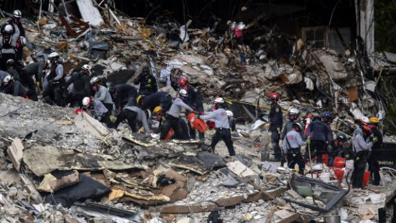Search-and-rescue teams look through the rubble of Champlain Towers South on June 29.