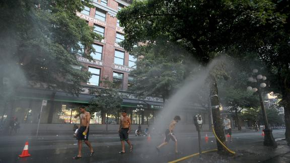 A temporary misting station on Abbott Street during a heatwave in Vancouver, British Columbia, Canada, on Monday, June 28, 2021. The heat is expected to continue for several days in some parts of British Columbia, according to weather warnings from the government. Photographer: Trevor Hagan/Bloomberg via Getty Images