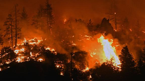 Flames from the Lava Fire burn along a ridge near U.S. Highway 97 and Big Springs Road north of Weed, Calif., on Monday, June 28, 2021. (Scott Stoddard/Grants Pass Daily Courier via AP)
