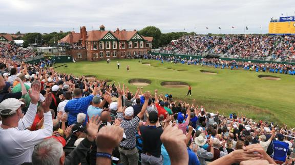 LYTHAM ST ANNES, ENGLAND - JULY 22:  Fans cheer as Ernie Els of South Africa reacts to a birdie putt on the 18th green during the final round of the 141st Open Championship at Royal Lytham & St. Annes Golf Club on July 22, 2012 in Lytham St Annes, England.  (Photo by Richard Heathcote/Getty Images)
