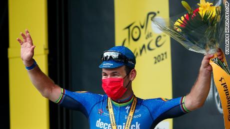 Cavendish celebrates on the podium.